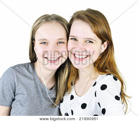 Two Teenage Girls Listening To Music