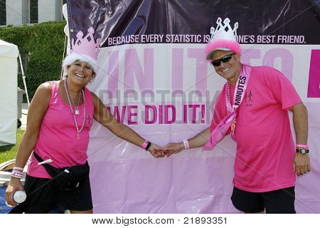 "CHICAGO - JUNE 5: Two participants in front of a ""We Did It!"" poster at the Avon Walk for Breast Cancer outside Soldier Field on June 5, 2011 in Chicago, IL."