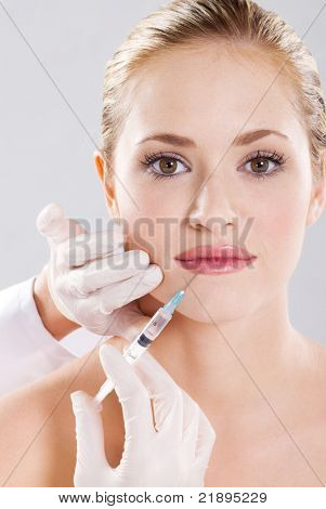 woman receiving a injection in her lip