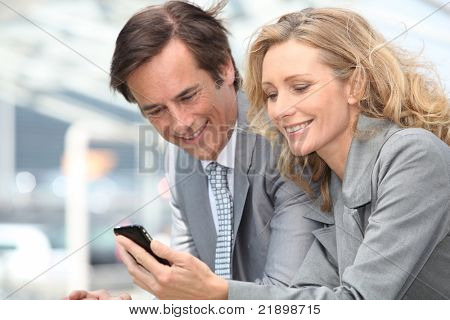 businessman and woman with phone