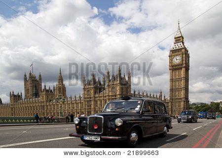 LONDON - MAY 31: A London Black Cab on Westminister Bridge on May 31, 2011. The Black Cabs are regulated by Transport For London and are the only vehicles for hire that can be hailed on the street.