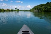 image of knoxville tennessee  - Bow of canoe floating down the French Broad River Knoxville Tennessee - JPG