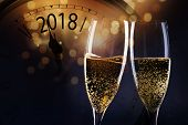 champagne glasses and gvintage clock showing 2018 ready to bring in the New Year poster
