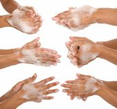 stock photo of soapy  - gesture of a beautiful woman hands washing her hands - JPG