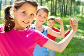 stock photo of little boy  - Three little children posing at camera - JPG