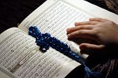 stock photo of forgiven  - Hand hold holy koran book & Worshiping