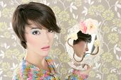 retro woman in mirror reflection fashion portrait on tacky vintage wallpaper