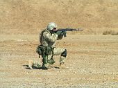 stock photo of special forces  - shoting soldier on desert sunny day image - JPG