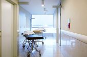 image of stretcher  - An intrior of a hospital hallway with a couple stretchers - JPG