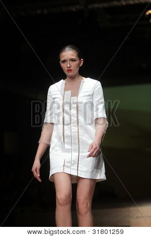 """ZAGREB, CROATIA - MARCH 24: Fashion model wears clothes made by Hippy Garden on """"CRO A PORTER"""" show on March 24, 2012 in Zagreb, Croatia."""