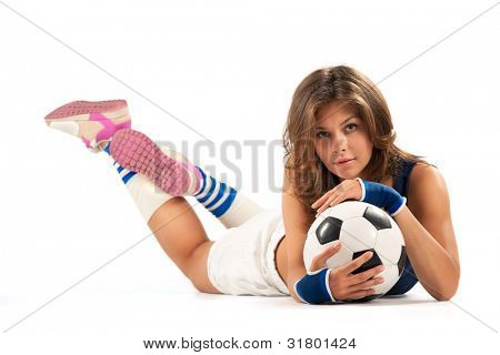 Sexy girl doing fitness with soccer ball over white background