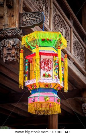 Traditional Chinese lantern hanging in the  wooden building with many chinese old style woodcarving
