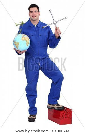 Mechanic holding a globe and a cross wheel spanner