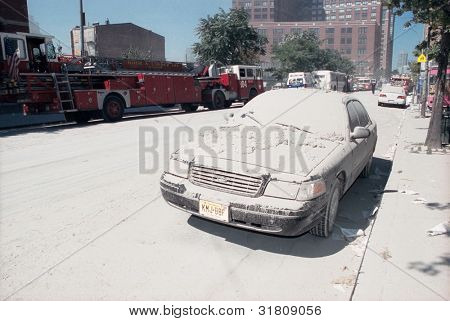 NEW YORK - SEPTEMBER 11: Ash covers a vehicle as it lies near the area known as Ground Zero after the collapse of the Twin Towers on September 11, 2001 in New York City.