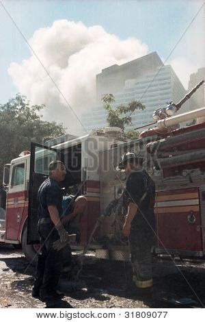NEW YORK - SEPTEMBER 11: New York City firefighters rest near the area known as Ground Zero after the collapse of the Twin Towers on September 11, 2001 in New York City.