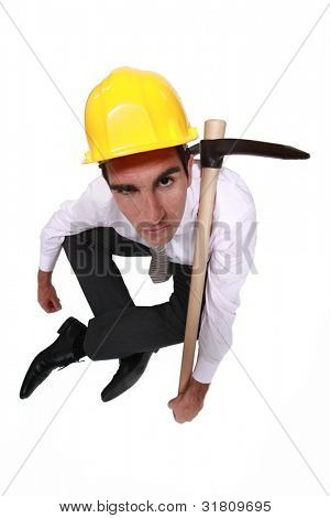 Grumpy businessman with a pickaxe
