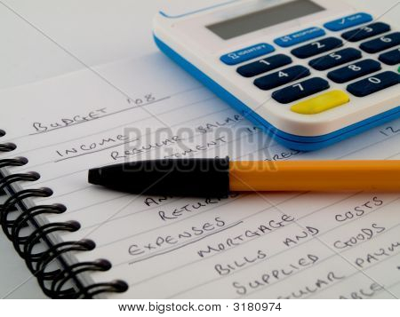 Bank Pin Number Security Calculator With Biro Pen Stylus On White Note Paper Showing A Home Or Small