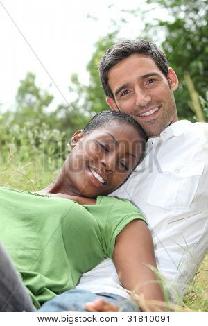 African woman and white man hugging