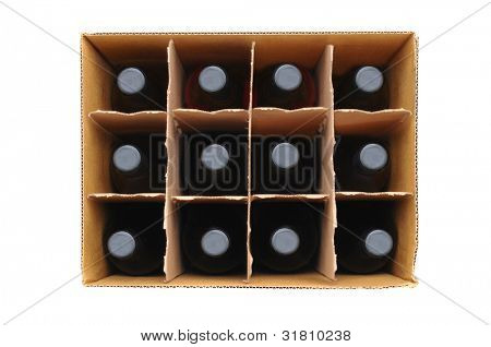 Overhead view of a twelve bottle case of red wine over a white background.