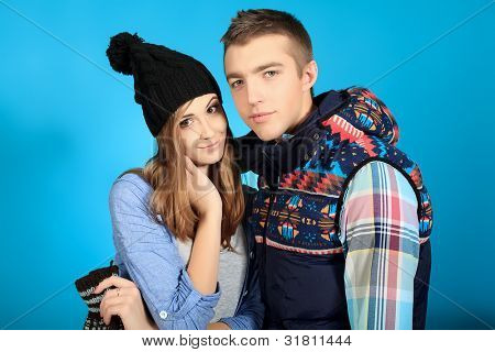 Portrait of a happy young couple in warm clothes.