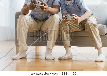 African American father and son playing video games