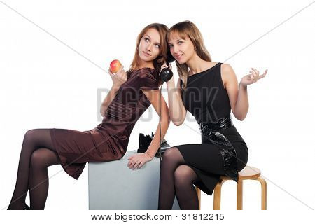 Two young women with a retro phone