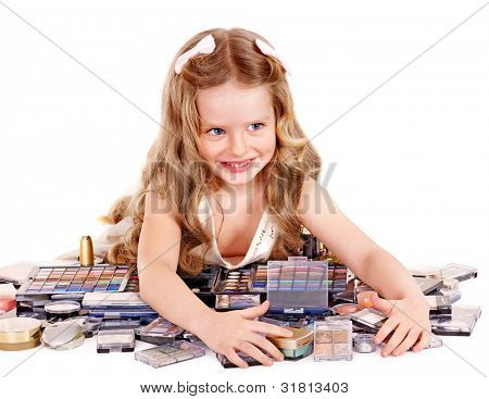Little girl with child cosmetics.