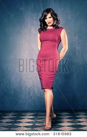 elegant mature woman in red tight dress, full body shot, room with blue walls and tiled floor