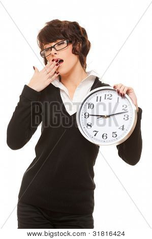 studio portrait of tired woman with clock. isolated on white