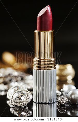 still life of jewelry  and high end lipstick