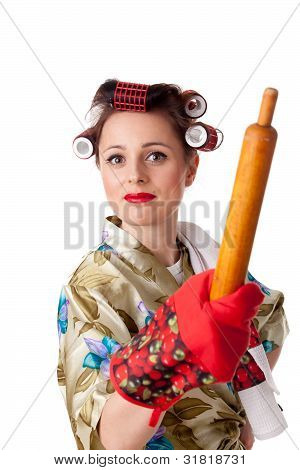 Young Angry Housewife With Roller For Dough.