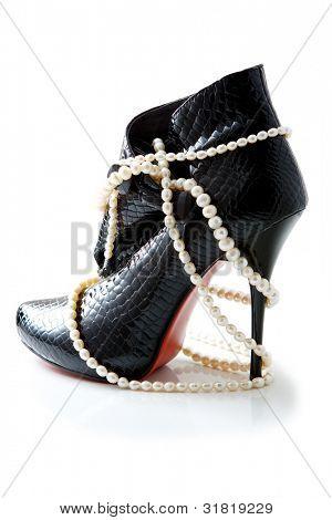 Black female crocodile boots isolated on white