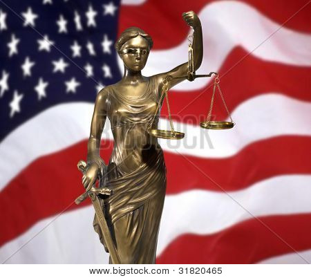 Lady of Justice on rippled US flag