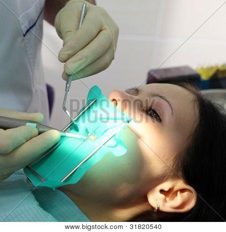 The dentist treats a teeth special tools