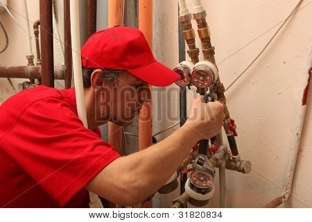 View of a plumber repairing a faucet