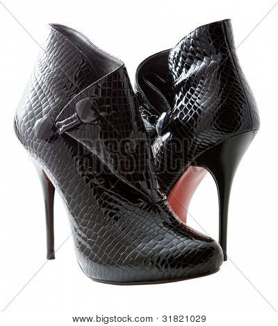 Black female crocodile boots isolated on white