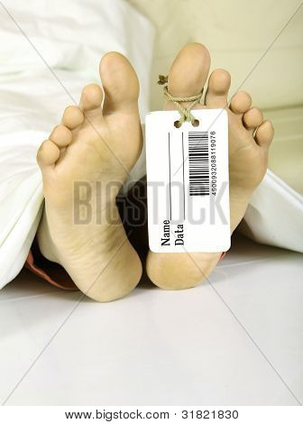 Human feet with toe tag bar code