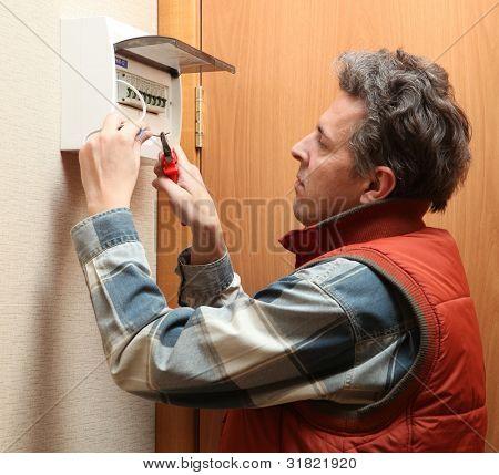The electrician establishes a fixture