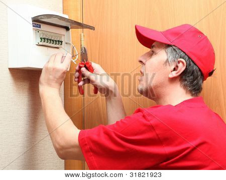 The electrician establishes a fixture