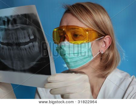 female doctor with jaw xray (focus on doctor)