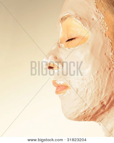 Woman in a health spa wearing a facial mask
