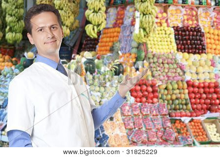 portrait of male seller fruit  looking at camera
