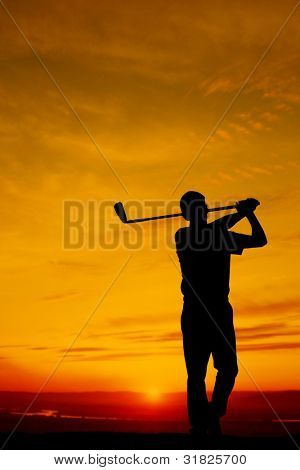 golfers at sunset