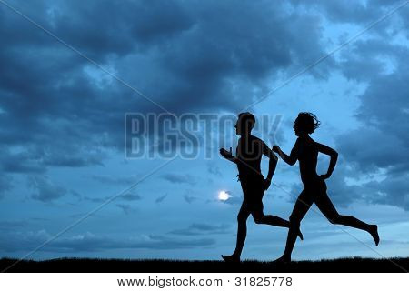 Woman and men running during sunset