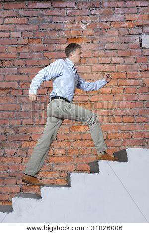 The man walks upwards on a ladder