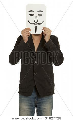 Man with the painted Guy Fawkes mask on the sheet of paper over his face isolated on white