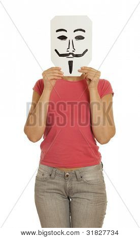 Woman with the painted Guy Fawkes mask on the sheet of paper over his face isolated on white