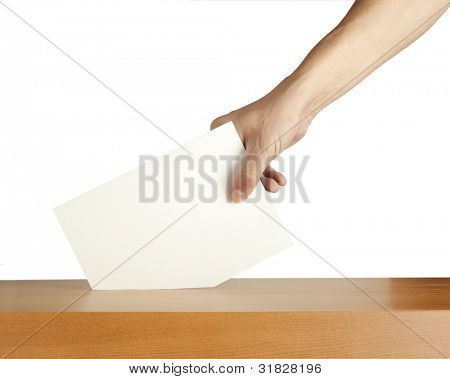 Hand putting a voting ballot in a slot of box isolated on white background