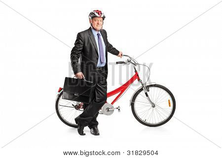 Full length portrait of a senior businessman posing next to a bicycle isolated on white background