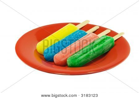 Four Popsicles On A Red Plate